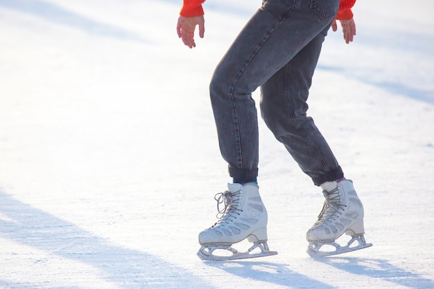 Girl ice skating on an ice rink