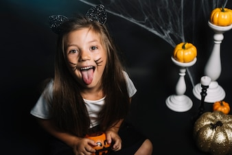 Girl in cat costume showing tongue
