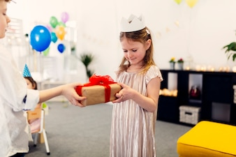 Girl in dress and paper crown on birthday