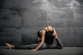 Girl in gym doing yoga