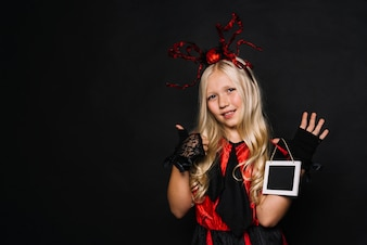 Girl in Halloween costume gesturing thumb-up