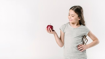 Girl in studio with red apple