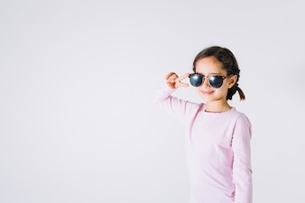 Girl in sunglasses gesturing peace