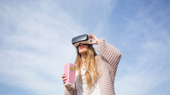 Girl in VR goggles outside