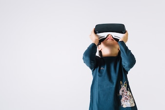 Girl in VR headset looking up