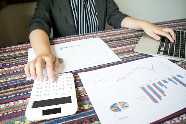 The girl is checking the company's finances to prepare her business development to the asi