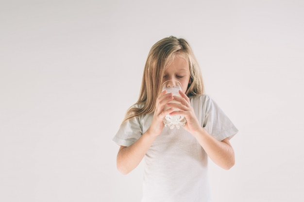 Girl is drinking fresh glass of milk