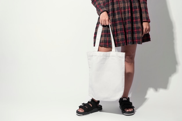 Girl is holding bag canvas fabric.