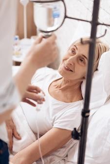 Girl is nursing elderly woman at home