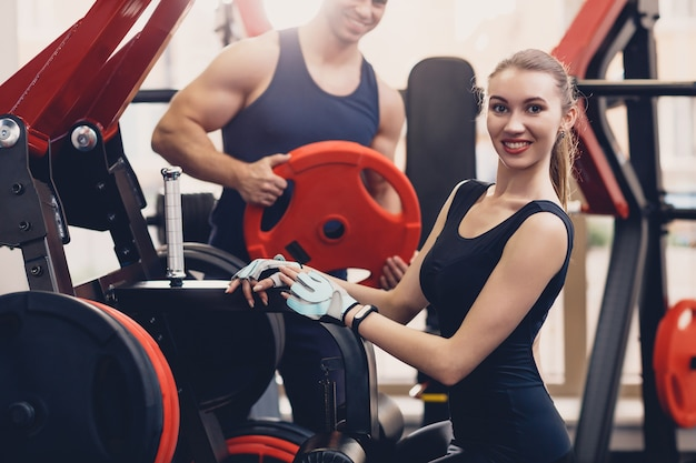Girl is preparing the exercise training apparatus