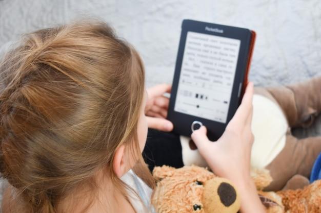 Girl is reading an e-book