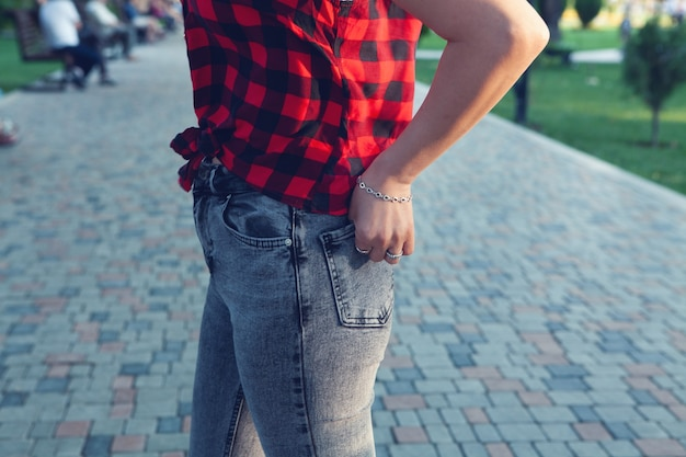 Girl in jeans standing in the park