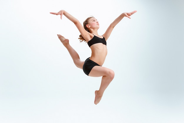 The girl jumping as modern ballet dancer