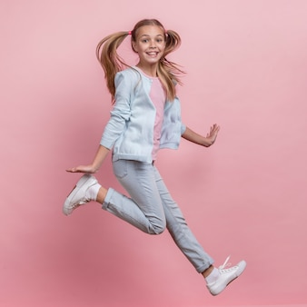 Girl jumping sideways and being happy