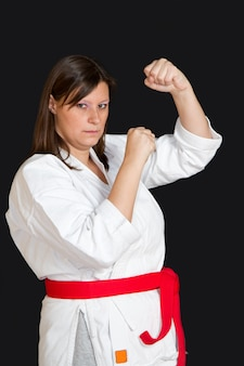 Girl in kimono doing karate
