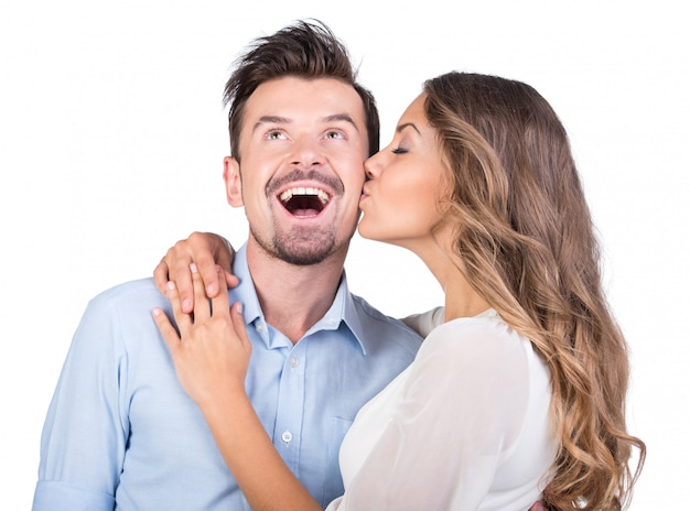 The girl kisses the guy, isolated photo