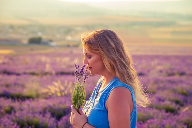 Girl in a lavender field at sunset. sunny summer evening in crimea.