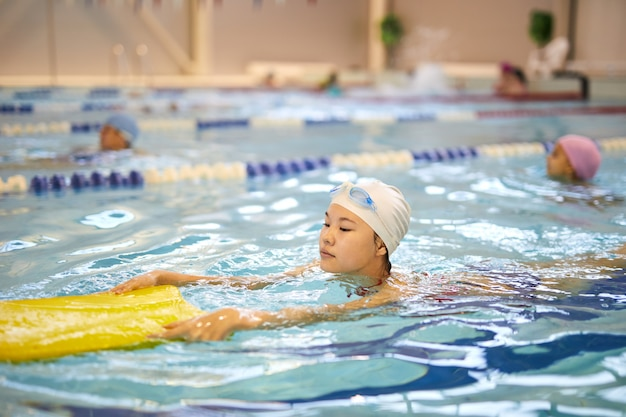Girl learning to swim