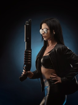 The girl in a leather jacket with a shotgun