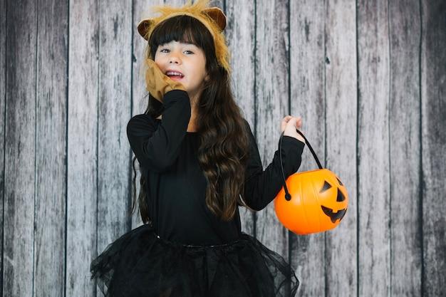 Girl in lion costume holding basket