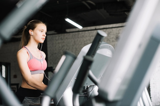 Girl listening to music at gym