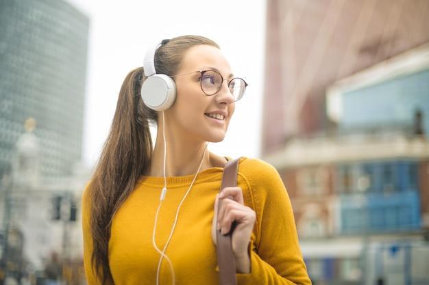 Girl listening music with headphone