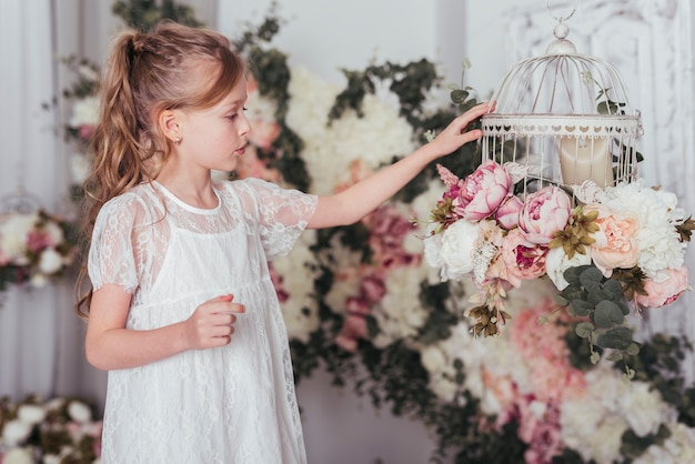 Girl looking at flower cage