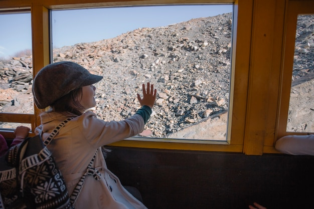 Girl looking at hill from train