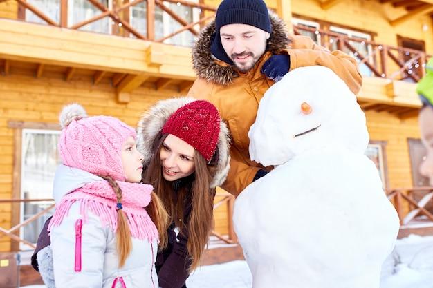Girl looking at snowman