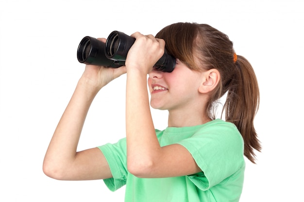 Girl looking through binoculars isolated on white background