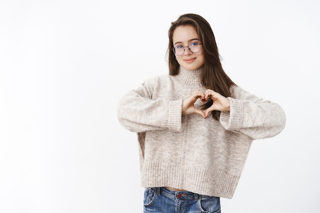 Girl loves cozy sweater in chilly weather