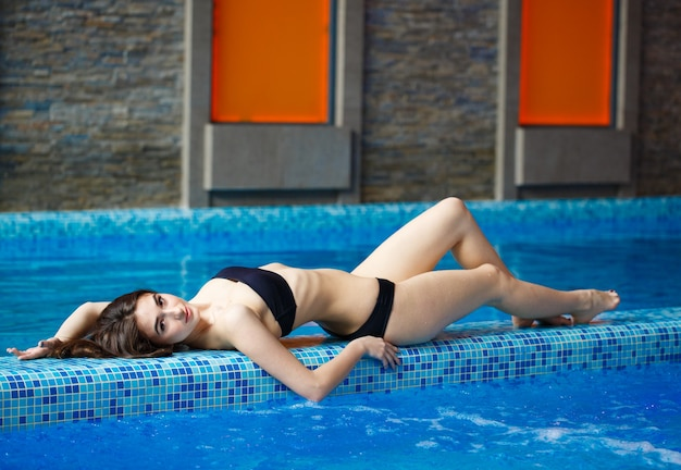Girl lying near the pool.