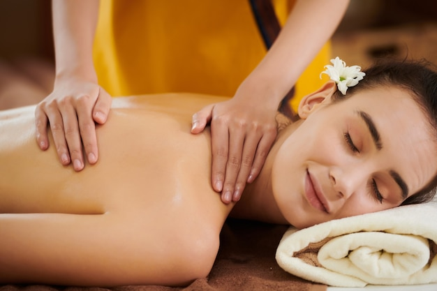 Girl lying in spa salon