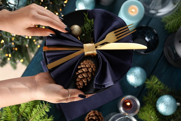 Girl makes new year table setting, top view and close up.