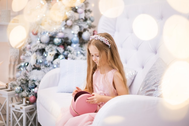 Girl makes a wish, dreams with the christmas tree