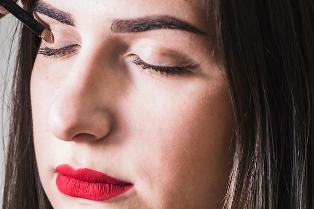 Girl making up her eyes