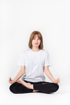 Girl meditating white