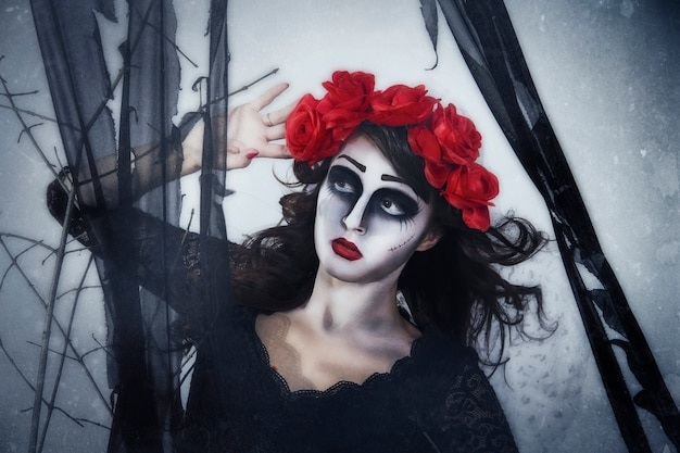 Girl mime in fog forest, halloween wreath on head
