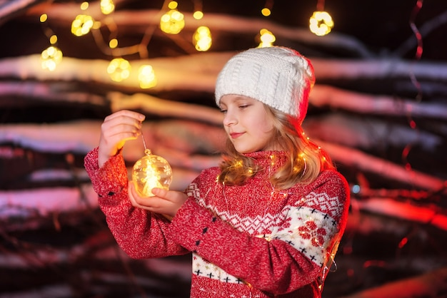 Girl model holding a christmas tree toy in her hands