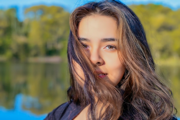Girl modeling at sunset in a park