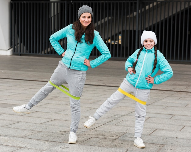 Girl and mom training with elastic bands