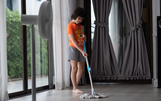 Girl mopping the house, asian kid cleaning