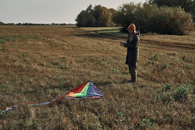 The girl in nature launches a kite. autumn weather.