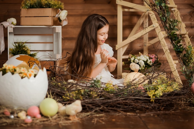 Girl in nest with chickens
