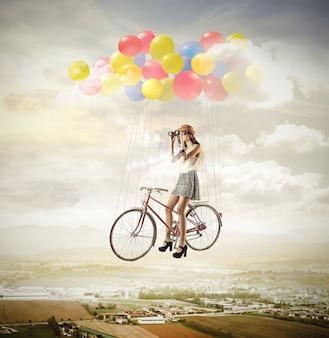 풍선 자전거에 소녀