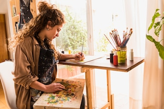 Girl painting a canvas