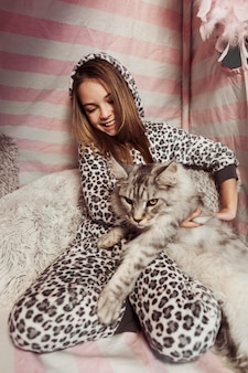 Girl in pajamas and cat