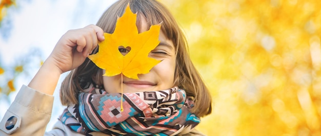 Girl in the park with autumn leaves.