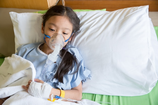 Girl patient treating and healing with respiratory mask equipment