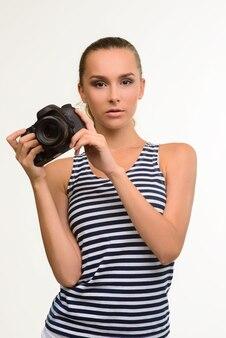 カメラを持つ女の子の写真家。